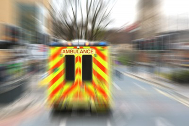 Image of ambulance at speed from the rear with blurred scenery